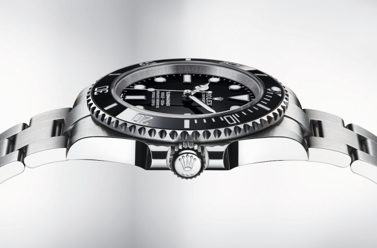 A side profile of the new Rolex Submariner, showing the watch face and the iconic Rolex crown.