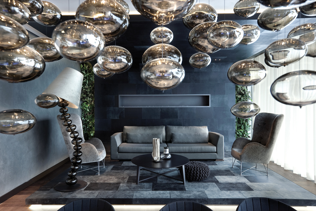 Eco-Chic, according to Robert Kolenik, in the show interior he designed as an apartment at the headquarters of the Dutch lighting specialists, Maretti