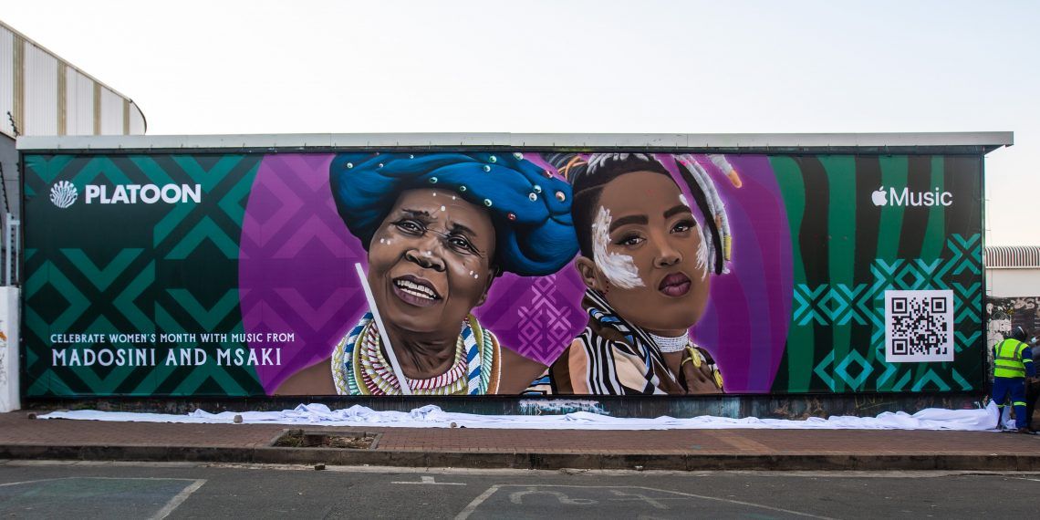 Baz-Art unveils second Women's Wall mural in Fox Street, Maboneng. Designed and executed by artist Dbongz, the wall features iconic musicians Madosini and Msak