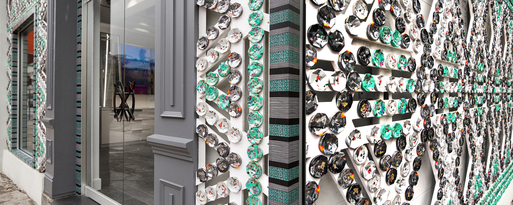 The façade of the Daily Paper NYC building is covered with panels created from crushed drink cans shaped in a pattern that evokes African beadwork.
